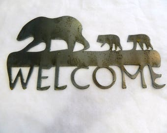 Metal art welcome sign with bears