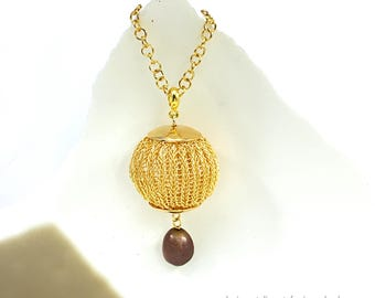 gold colored copper wire crochet ball pendant with fresh water pearl