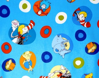 Cat in the Hat toss by Dr. Seuss from Robert Kaufman, 100% cotton fabric for Quilting and general sewing projects.