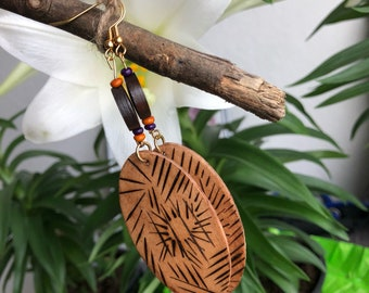 Wood burned one of a kind eclectic earrings.