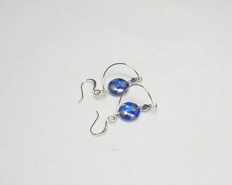 Blue polka dot earrings with twist