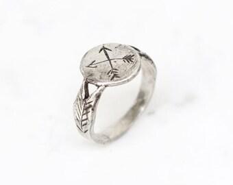 Silver crossed arrows signet ring