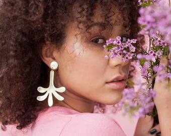 Statement gold leather palm earrings