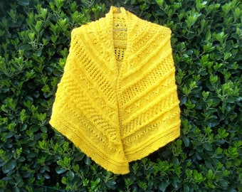 large yellow hand knitted shawl