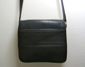 Vintage  black leather bag by coach, shoulder strap, flap and zipper