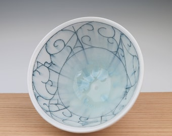 Handmade porcelain thrown bowl with scroll pattern