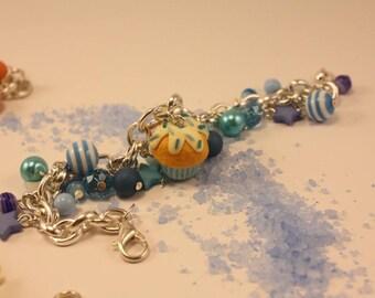 multicharm bracelet with handmade polymer clay cupcake