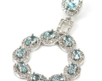Sterling Silver Sky Blue Topaz Gemstone & AAA CZ Accents Pendant