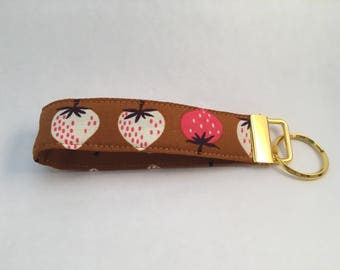 Key fob with strawberries and gold tone hardware
