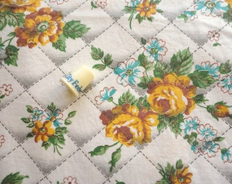 gold flowers on a quilted ground vintage cotton fabric -- 36 wide by the yard