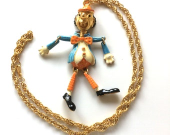 Gold enamelled metal, sold with chain articulated CLOWN pendant
