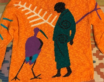 Vtg 80s avant garde minimalist batwing sweater ethnic bird Egyptian orange