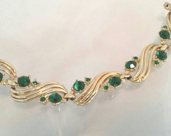 Vintage Coro green rhinestone gold tone bracelet with safety chain.