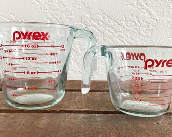 Vintage set of Pyrex measuring cups; red lettering, clear glass with blue tint; 1980s