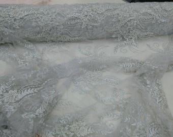 Fortune bridal wedding beaded mesh white fabric lace. Sold by the yard.