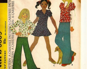 "A Collared, Puff Long/Short Sleeve Top with Back Ties, Flared Skirt and Wide Leg Pants Pattern for Girls: Size 7, Breast 26"" • McCall's 3889"