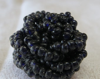 "Vintage button, strung dark purple beads (look black) in a 'blackberry' shape. 0.75""X0.5""ins, fabric mounted. Thread sew loop. UNK18.4-17.7"