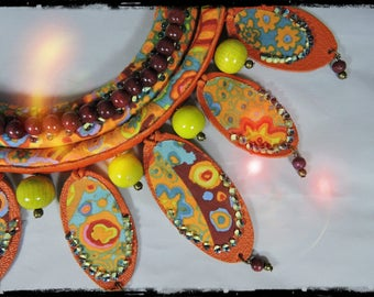 SOLD - Ingrid-necklace ESMERALDA fabric predominantly orange and yellow - orange leather, wood beads