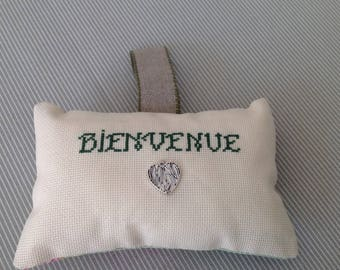 Welcome door pillow with silver metal heart