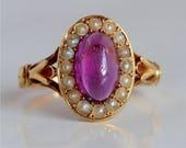 18 carat gold purple sapp...