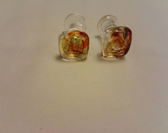 Glass cufflinks clear with amber swirl