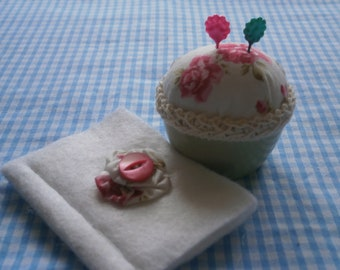 Vintage stoneware egg cup repurposed into a pincushion with matching needlecase