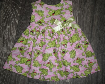 Babies pink and green frog fabric dress.