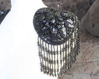 Cute beaded and embroidered applique with sequence black color 1 pieces listing 5 1/2 inches in diameter 4 inch long beading