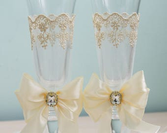 Gold and ivory Wedding flutes lace bow champagne toasting glasses rustic Wedding toasting flutes for the bride and groom Mr and Mrs