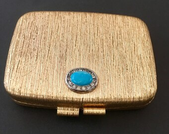 Vintage Revlon Love Compact with mirror and Vintage Powder Make Up. Gold Toned.