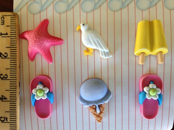 Beach buttons for scrapbooking, sewing and other crafts includes: flip-flops, starfish, seagulls, ice creams cones , and popsicles