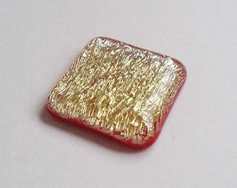 Square cabochon, red and gold dichroic fused glass.