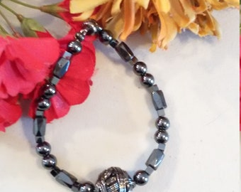 Black hematite magnetic beaded bracelet with black wire spherical focal bead.