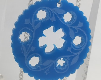 Blue Dorcas pin tin inspired acrylic necklace pendant Laser cut from acrylic. by Emily M A Parkin
