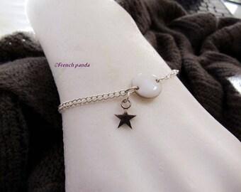 White enameled silver bracelet and charm.