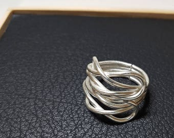 99% Silver ring with unique design. Adjustable Ring. Swirl Design Ring