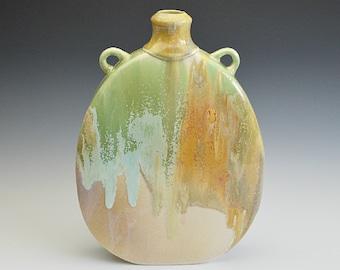 Porcelain bottle vase handshaped