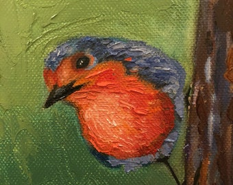 A robin on a tree, small painting on a stand, oil on canvas, original painting, signed