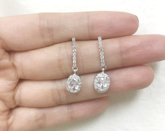 Bridal Sterling Silver Rhodium Plated Round Clear Channel CZ with Oval Halo Dangling Stud Earrings | Special Occasion| Anniversary Gift | Br