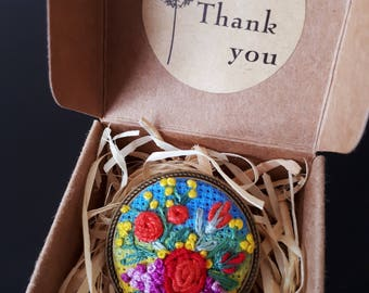 Embroidery brooch with flowers in antique frame