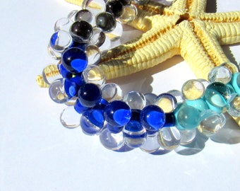 SMAUGGS handmade beadset BOBBELS (10pcs., 15mmx7mm), glass, darkblue, transparent, hole 2mm