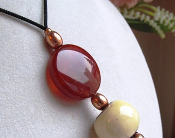 Pendant of 30mm Carnelian Flat Coin and White Bone Drum Beads with Copper Silk