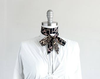 Black and tan skinny scarf with gallery birds and leopard, choker, bow, hair tie
