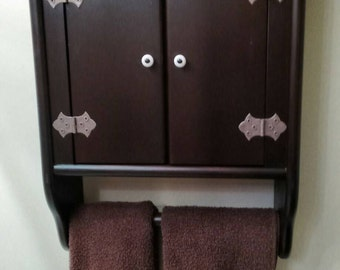 Bathroom wall hung cabinet with towel rack.