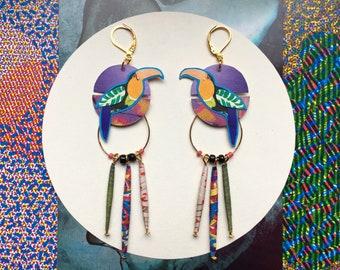 Earrings: birds of the Islands.