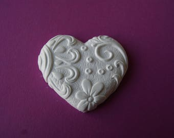 heart in plastered with leaves and flowers