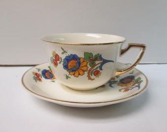Homer Laughlin floral tea cup with Matching Saucer with Gold Leaf Edging