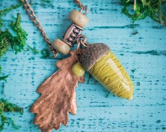 Acorn pendant_glass acorn_mustard green_electroformed oak leaf_artisan lampwork glass_woodland overhead necklace_druid wiki pagan