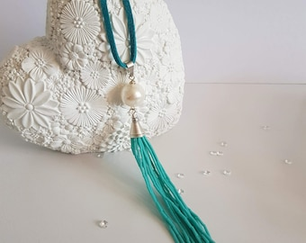 Turquoise blue necklace with a large pearl