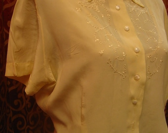 "1950's, 42"" bust, cream colored rayon crepe blouse, with embroidered top front"